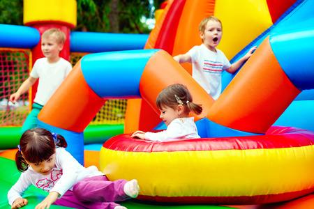 Photo pour happy kids having fun on inflatable attraction playground - image libre de droit