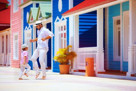 Photo for happy father and son enjoy life, dancing on caribbean street - Royalty Free Image