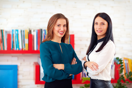 Photo pour portrait of two pretty business women in office - image libre de droit