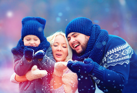 Foto de portrait of happy family blowing winter snow - Imagen libre de derechos