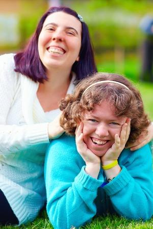 Foto de portrait of happy women with disability on spring lawn - Imagen libre de derechos
