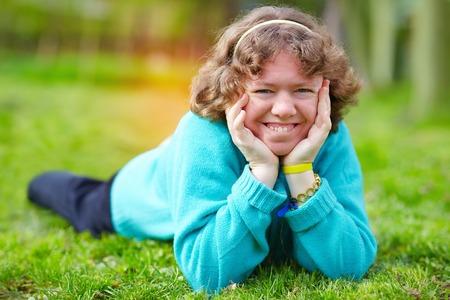 Foto de happy woman with disability having fun in spring park - Imagen libre de derechos
