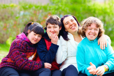 Foto de group of happy women with disability having fun in spring park - Imagen libre de derechos