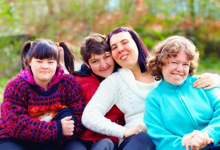 Foto de group of happy women with disability having fun in spring park - Imagen libre de derechos