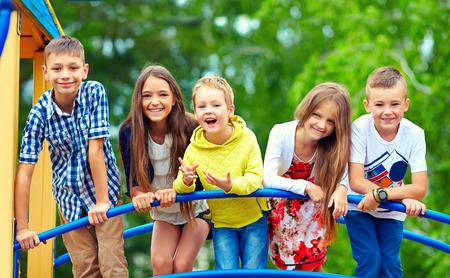 Foto de happy excited kids having fun together on playground - Imagen libre de derechos