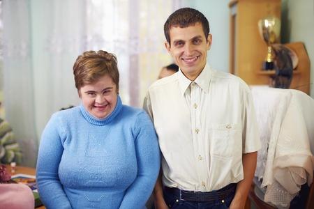 Foto de portrait of two happy friends with disability in rehabilitation center - Imagen libre de derechos