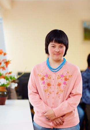 Foto de portrait of young adult woman with down's syndrome - Imagen libre de derechos
