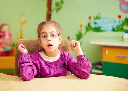 Foto de cute little girl in kindergarten for kids with special needs - Imagen libre de derechos