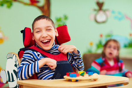 Foto de cheerful boy with disability at rehabilitation center for kids with special needs - Imagen libre de derechos
