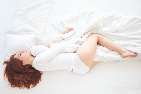 Photo pour top view of young woman sleeping peacefully in bed - image libre de droit