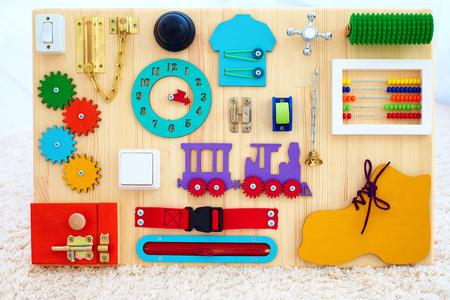 Foto de handmade busy board for baby fine motility skills development - Imagen libre de derechos