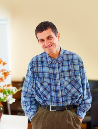 Foto de portrait of cheerful adult man with disability in rehabilitation center - Imagen libre de derechos