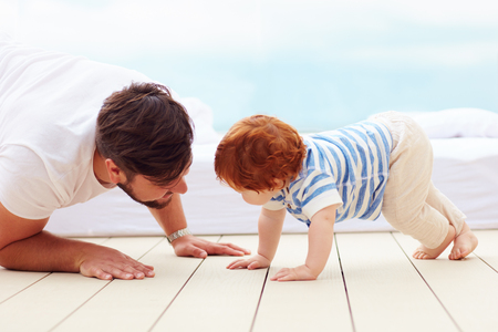 Photo pour father playing with his little son on the floor - image libre de droit