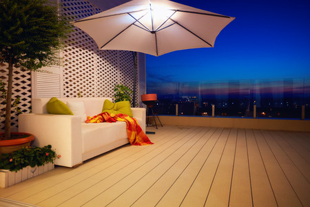 Photo for beautiful modern rooftop patio, terrace with evening city view - Royalty Free Image