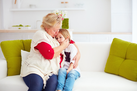 Foto de granny soothing her sad grandson at home - Imagen libre de derechos
