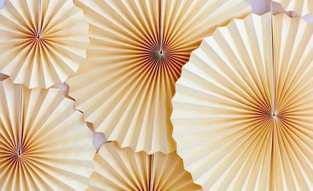 Foto de traditional paper medallion, fan decorate the wall on party celebration - Imagen libre de derechos