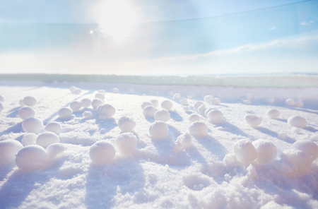 Foto de a lot of snowballs on the snow at sunny frosty winter morning - Imagen libre de derechos