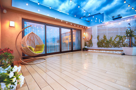 Photo for evening patio area with sliding doors - Royalty Free Image