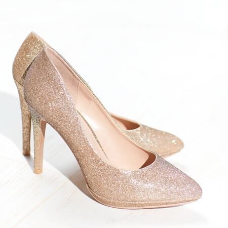 Photo for golden high heel shoes, cinderella pointy pump shoe - Royalty Free Image