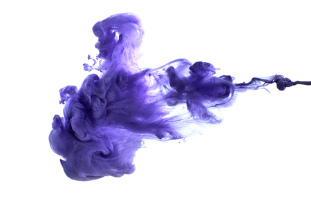 Foto de Purple acrylic paint in water. Studio photography on a white background. - Imagen libre de derechos