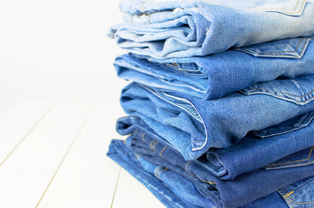 Foto de Jeans on a light background. Detail of nice blue jeans. Jeans texture or denim background. Clothing, Fashion - Imagen libre de derechos