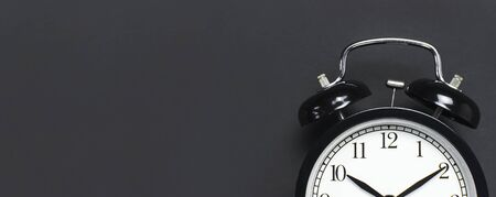 Photo for Black retro alarm clock on gray dark background - Royalty Free Image