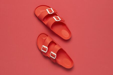 Photo for Fashionable beach coral birkenstock on bright coral background. Flat lay, top view, copy space. Creative beach concept, stylish summer shoes, vacation, travel. Coral color. Summer background. - Royalty Free Image