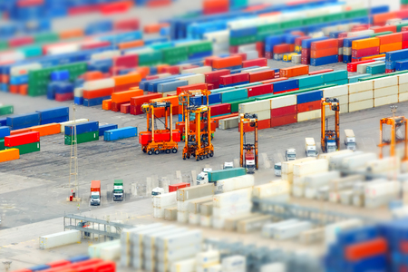 Photo for View of the cargo port and container terminal of Barcelona with the Montjuic hill, Barcelona, Catalonia, Spain. Shallow depth of field. - Royalty Free Image
