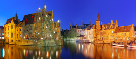 Photo for Scenic panorama with medieval fairytale town and tower Belfort from the quay Rosary, Rozenhoedkaai, at night, Bruges, Belgium - Royalty Free Image