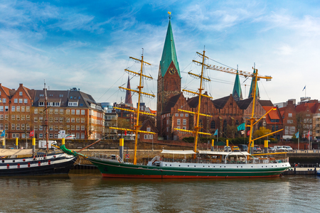 Photo for Embankment of the Weser River and Protestant Lutheran Saint Martin Church in the old town of Bremen, Germany. - Royalty Free Image