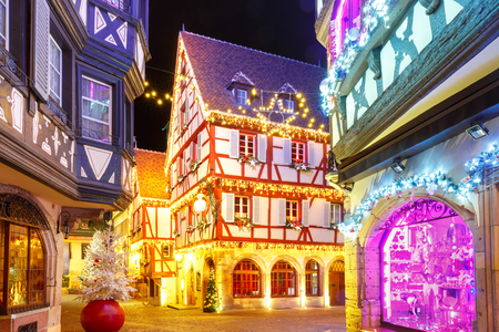 Foto de Traditional Alsatian half-timbered houses in old town of Colmar, decorated and illuminated at christmas time, Alsace, France - Imagen libre de derechos