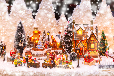 Photo for Santa Claus, Christmas tree and toys at a Christmas souvenir market shop in Strasbourg, Alsace, France - Royalty Free Image