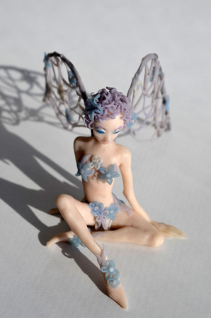 Photo for Figurine of a little winged fairy girl, front view - Royalty Free Image