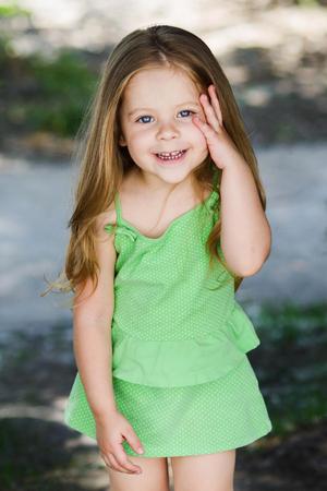 Foto de Cute little curly hair blonde girl facepalming forgetting something - Imagen libre de derechos