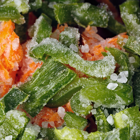 Cooking of frozen vegetables and spices.