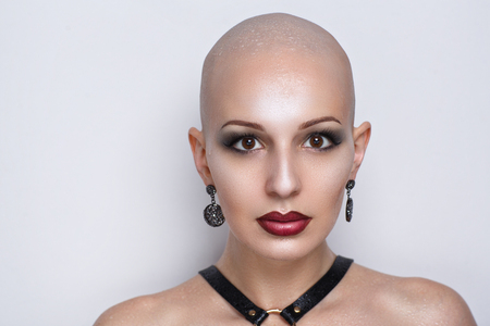 Photo for Close up portrait of beautiful bald woman. Wet skin, drops of water or of tears running down her face, shoulders. Sexy passionate girl with informal strange appearance. Challenging society, cut hair - Royalty Free Image