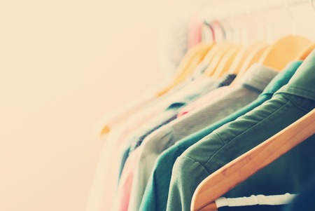 Photo for Pastel Color Clothes. Female Dresses on Open Clothes Rail. Toned image - Royalty Free Image