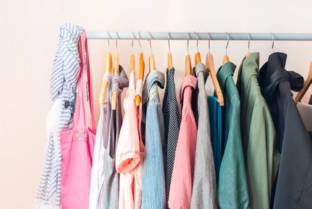 Foto de Pastel Color Female Clothes in a Row on Clothes Rail - Imagen libre de derechos