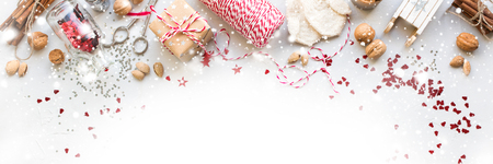 Foto de Banner Christmas Decorations Box Nuts Cord Fir Toys Glitter Cinnamon Sledge Mittens Natural Gifts on Grey Background - Imagen libre de derechos