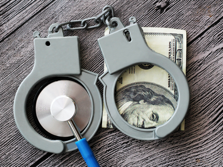 Photo pour medical stethoscope on dollar bills, extra close up - image libre de droit