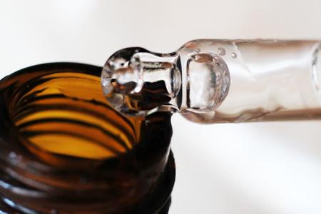 Foto de Hyaluronic acid in a bottle with pipette, macro - Imagen libre de derechos