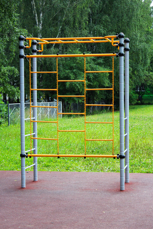 Photo for Outdoor sport simulator. Street workout exercise. Object - Royalty Free Image