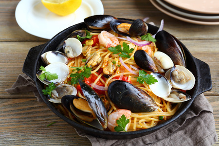 Pasta with seafood in a pan, nutritious food