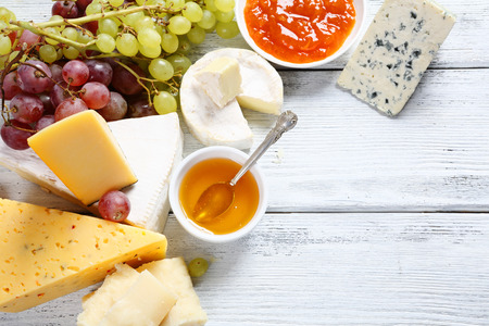 Photo for Gourmet cheeses with honey, food - Royalty Free Image