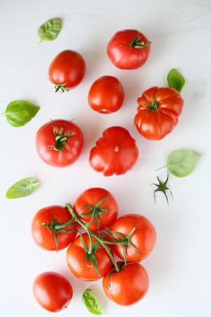 Photo pour fresh tomatoes on white wooden background, top view - image libre de droit