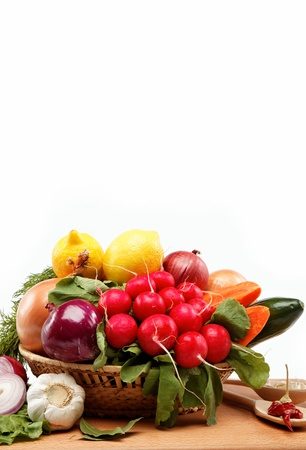 Healthy food. Fresh vegetables and fruits on a white background.