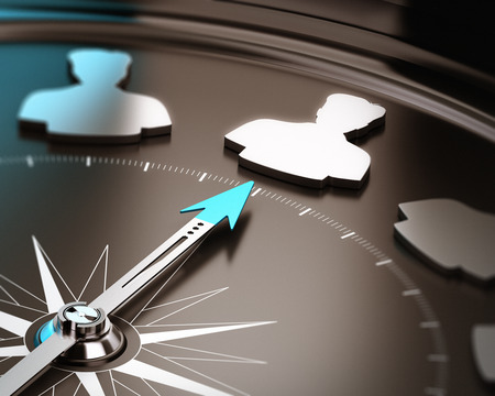Photo pour Recruitment or hiring qualified candidate concept  Compass needle pointing a talent symbol over a brown and blue background with focus and blur effect  - image libre de droit