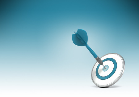 Photo pour One dart hitting the center of a target over gradiant background from blue to white. Concept illustration of setting business goals or objectives and achieve it. - image libre de droit