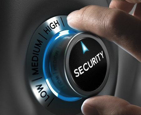Foto de Security button pointing the highest position with two fingers, Conceptual image for risk management - Imagen libre de derechos