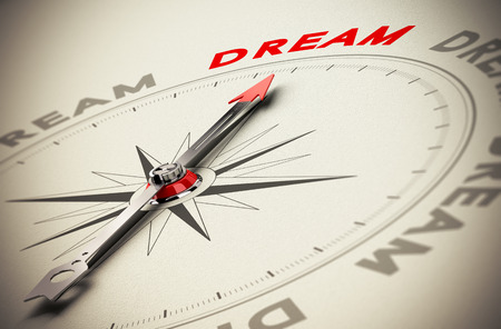 Photo for Compass with red needle pointing the word dream, beige paper background, symbol of achieving dreams - Royalty Free Image